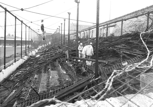Investigators amongst the debris of the Valley Parade stand afte
