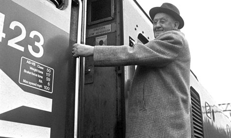 Burnley FC chairman Bob Lord climbs into the driver's cab for a ride on the footplate