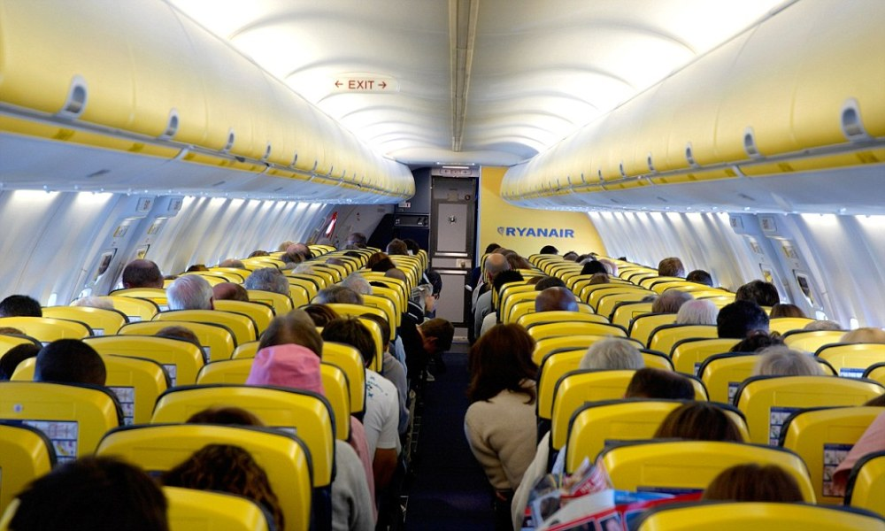 People in transit on a Ryanair plane